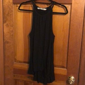 Black loose tank with keyhole opening. Wrap front.